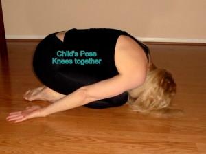 child's pose knees together